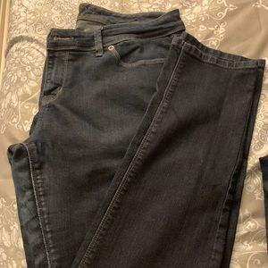 The limited dark wash skinny jeans